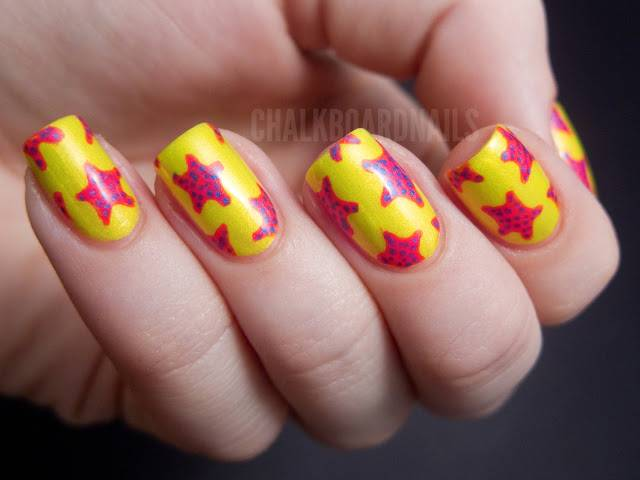 Yellow Nails With Pink Starfish Nail Art Design