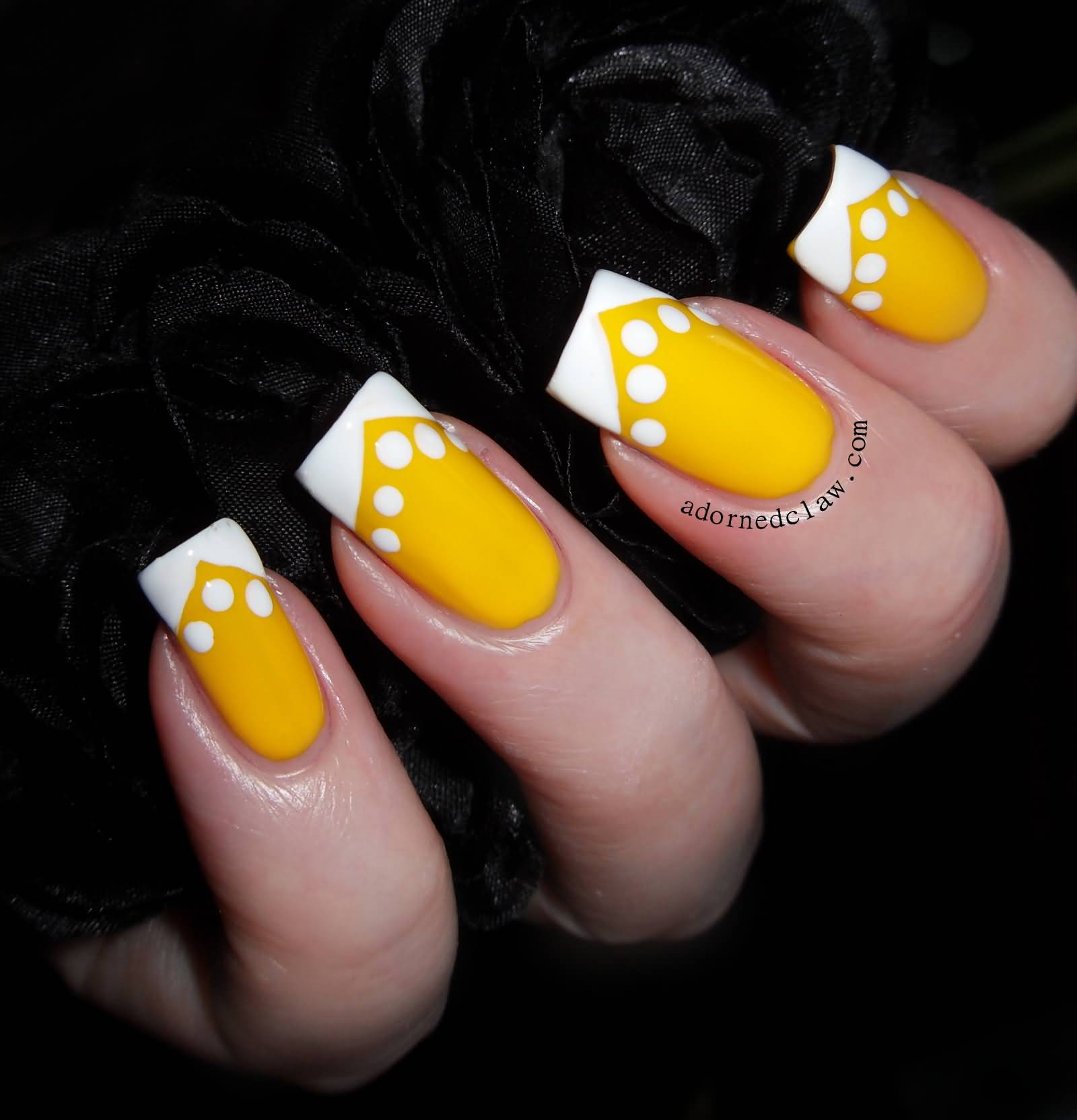 yellow nails with white dots and chevron tip design nail art