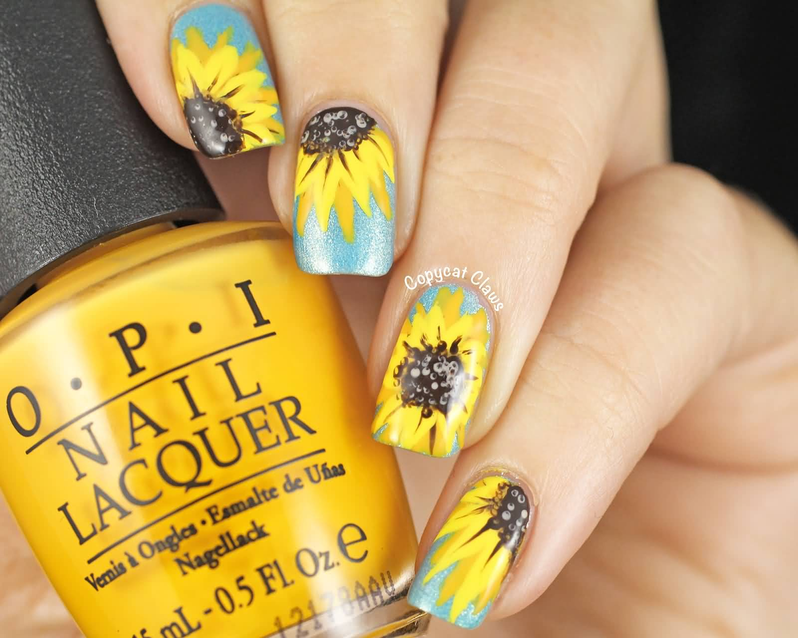 Yellow Sunflower Nail Art Design On Blue Nails