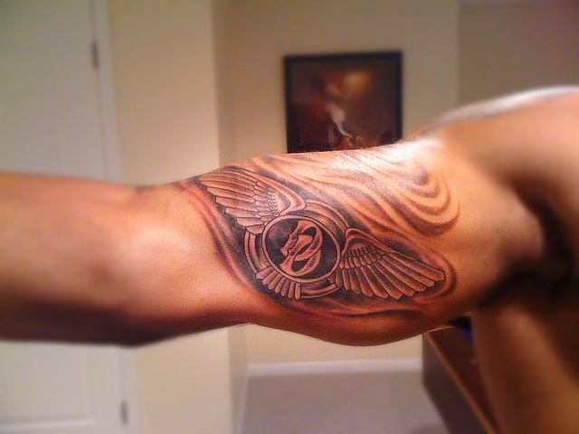 f153a805d Awesome Bentley Logo Tattoo On Biceps By Angel Bustos