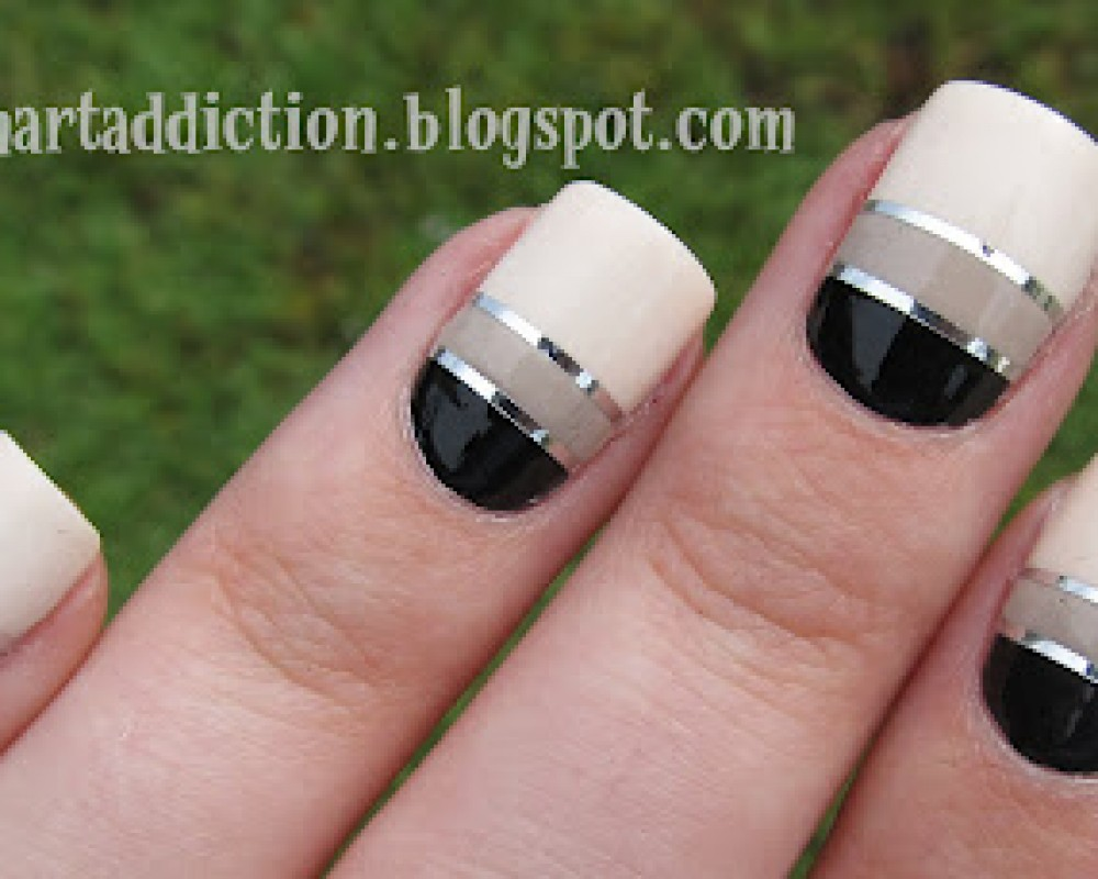 beige and black with silver striping tape design nail art