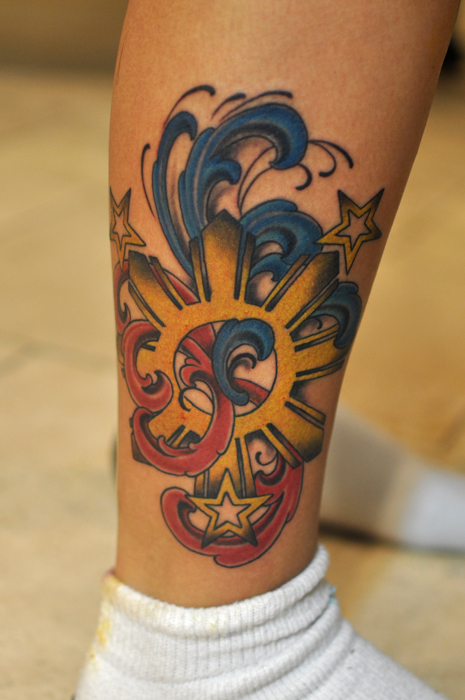 cool colored sun filipino tattoo on leg. Black Bedroom Furniture Sets. Home Design Ideas
