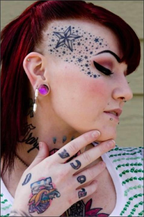 11 extreme tattoos for girls for Girl with star tattoos on face