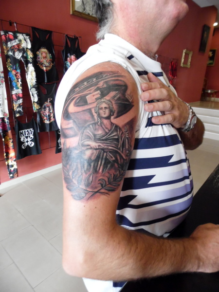 Grey ink real madrid ripped skin tattoo on left half sleeve for Real madrid tattoos