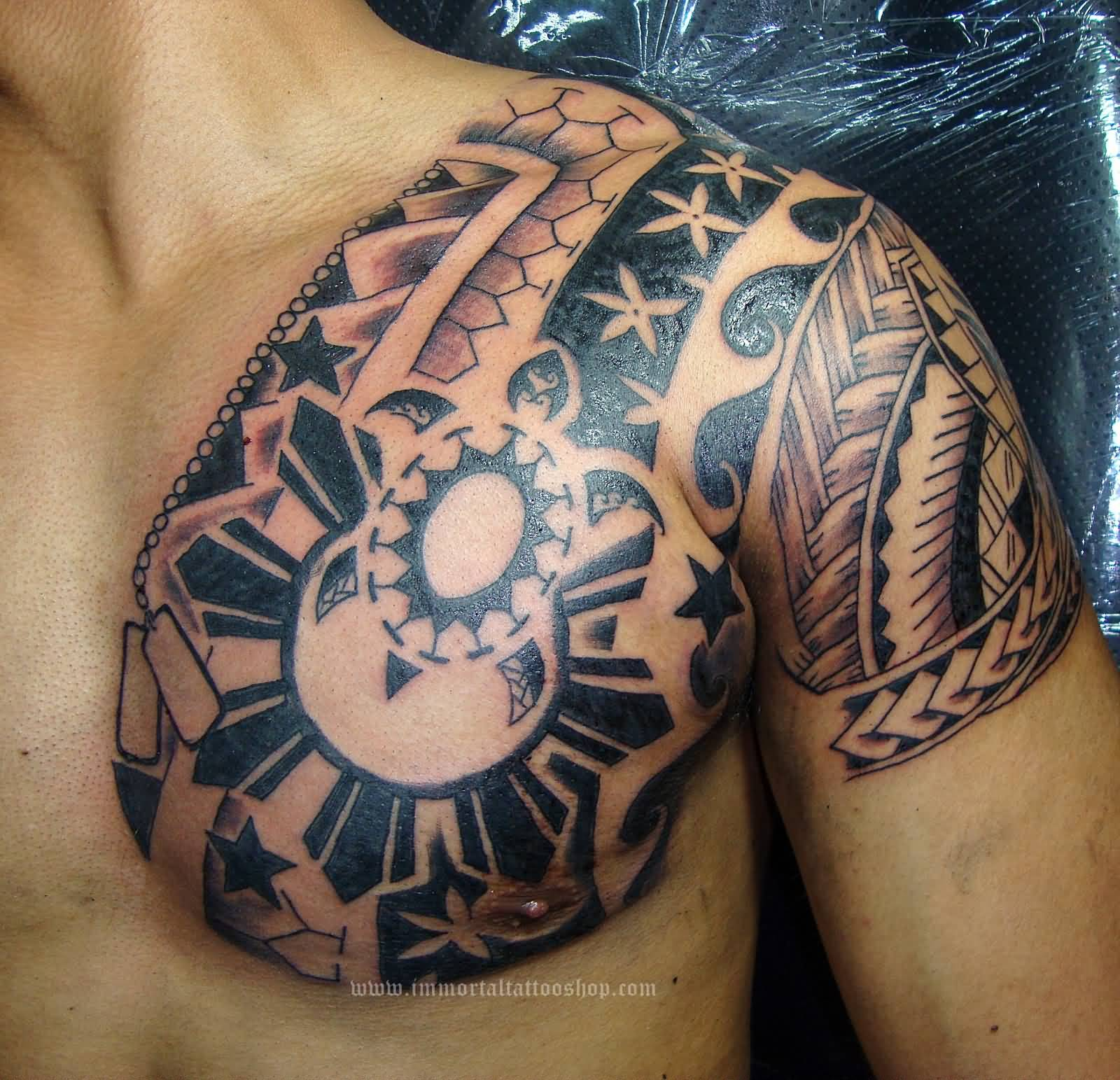 man chest and left shoulder filipino tattoo. Black Bedroom Furniture Sets. Home Design Ideas