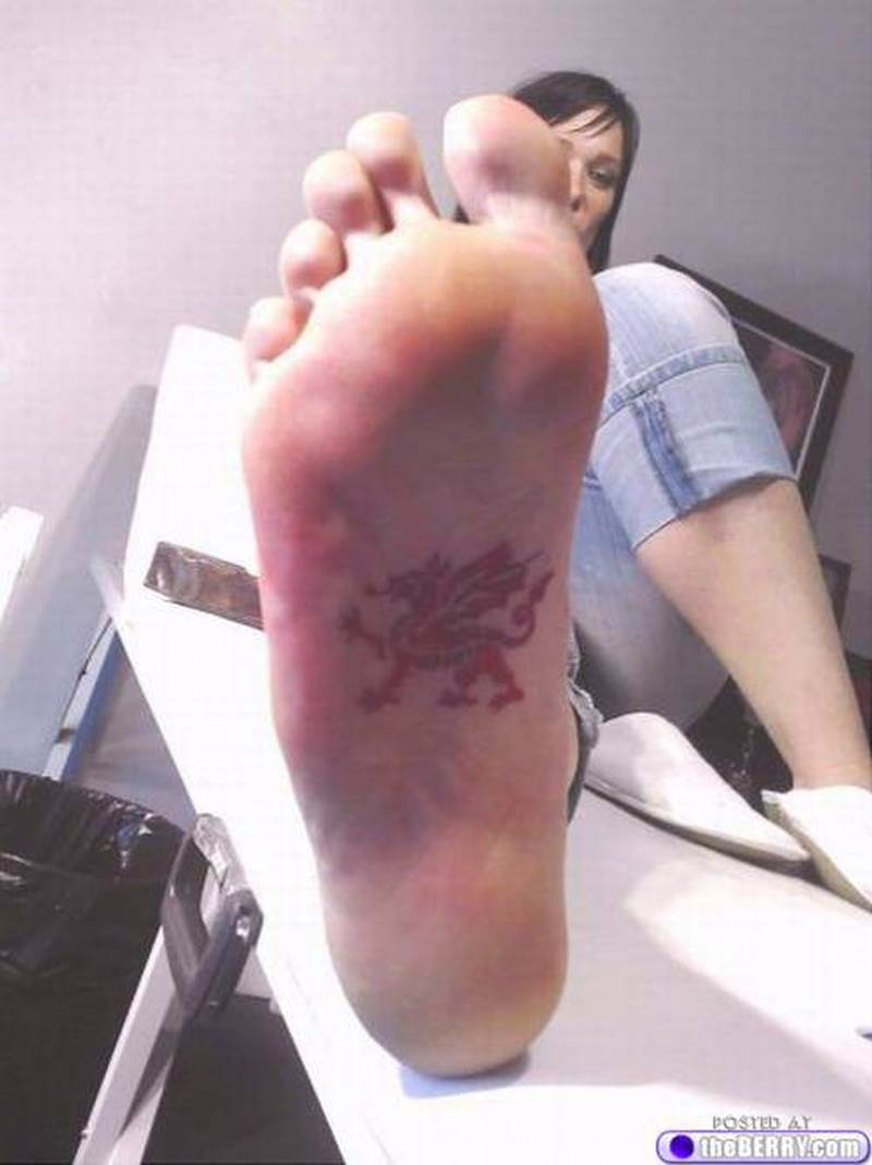 Small dragon symbol tattoo on sole of foot for girls biocorpaavc Gallery