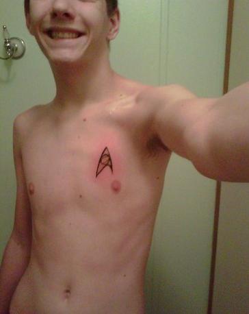 smallest star trek insignia tattoo on boy chest