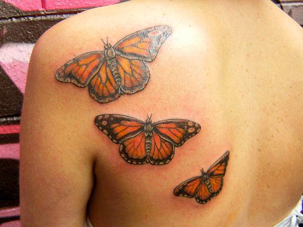 Superb Monarch Butterflies Tattoo On Back