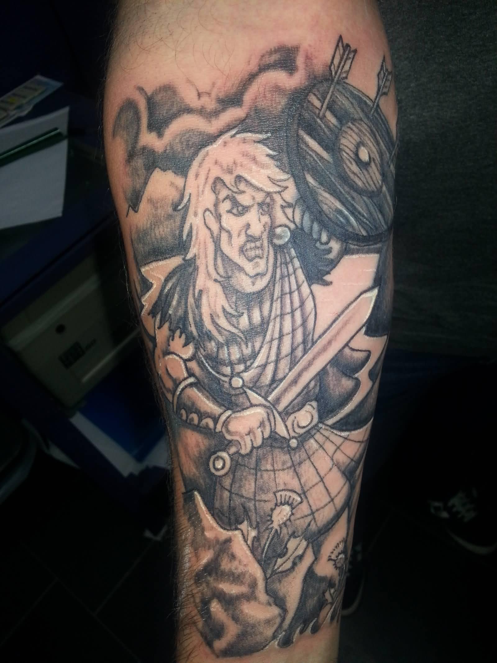 terrific scottish warrior tattoo on forearm