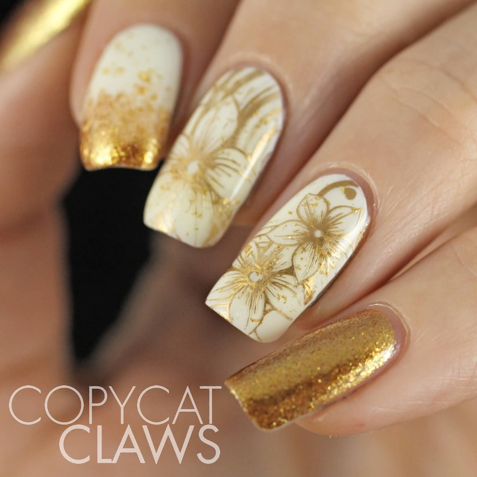 White Nails With Gold Flowers Nail Art