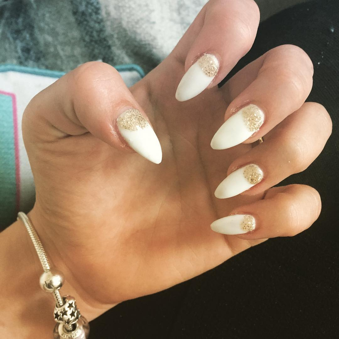 White Nails With Gold Glitter Reverse French Nail Art