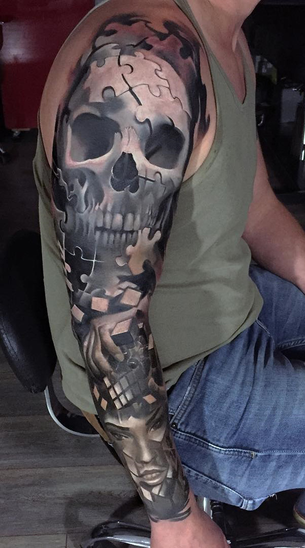 3cc2ff2a90d43 Amazing Scary Puzzle Tattoo On Full Sleeve
