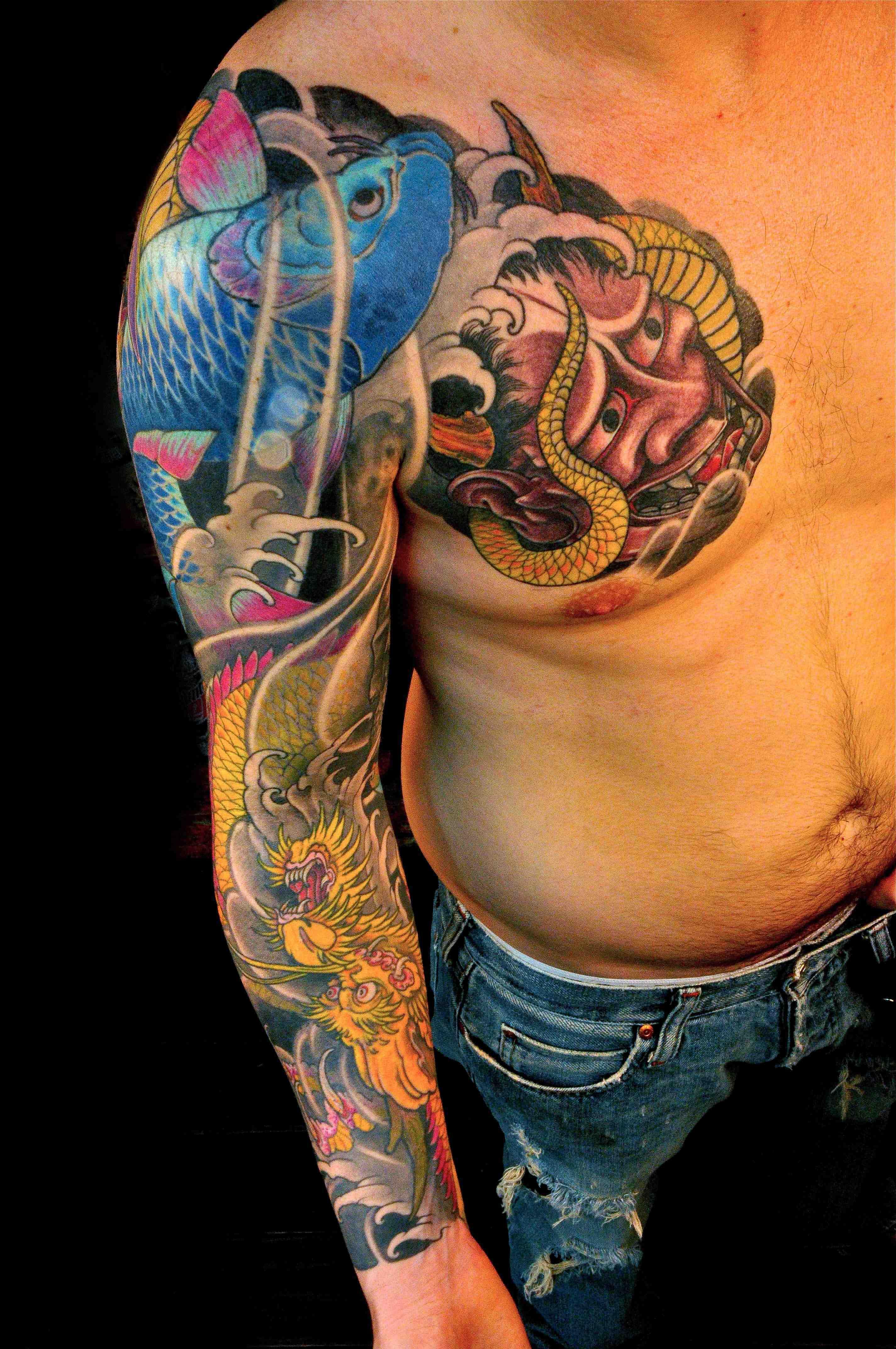 Chris Nunez Tattoo On Chest And Right Sleeve