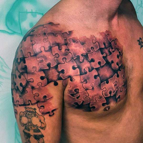 Realistic man shoulder and chest puzzle tattoo for Puzzle piece tattoo ideas