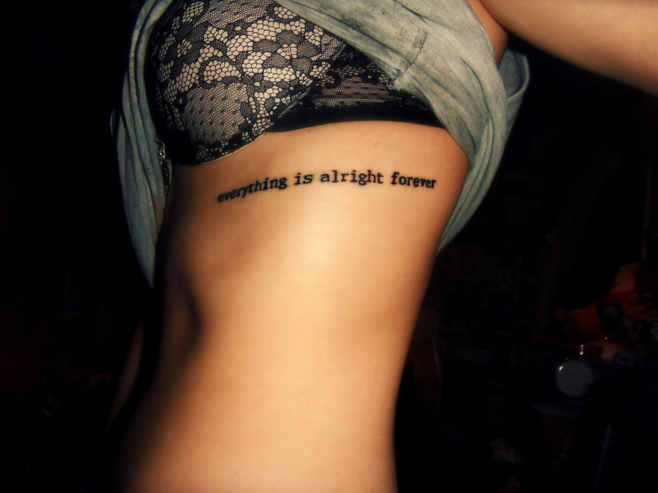 Short Quote Tattoo Girl Rib Cage