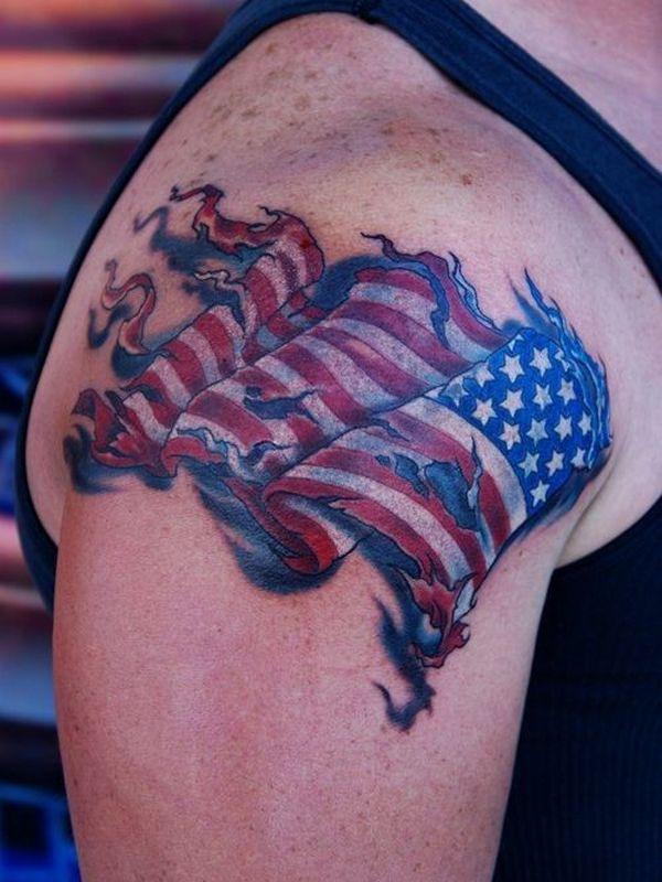 Torn Flying US Flag Tattoo On Shoulder