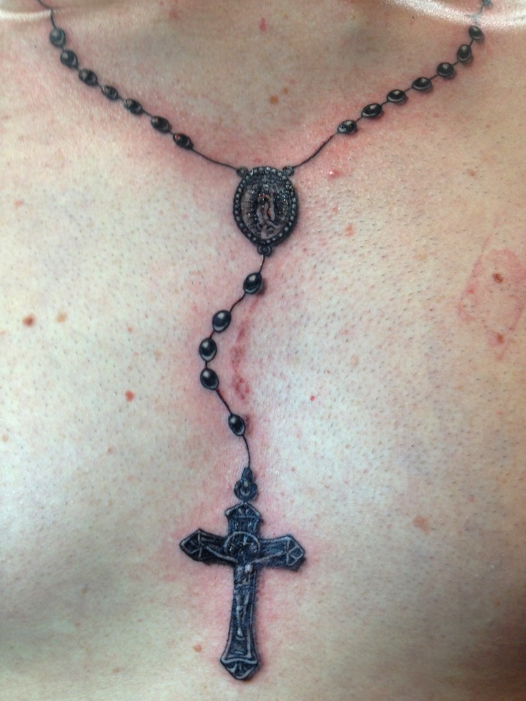 754105f64 Awesome Black Rosary Tattoo On Man Chest