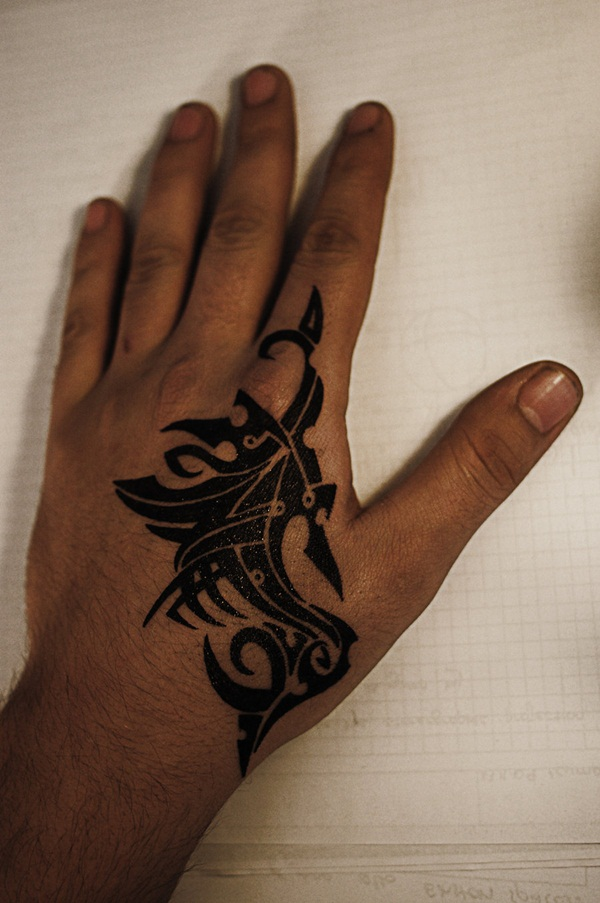awesome black tribal hand tattoo design for men