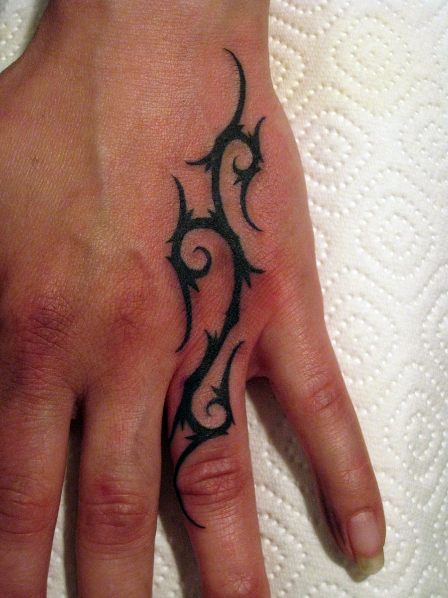 Tribal-Tattoos Awesome-Black-Tribal-Tattoo-On-Left-Hand