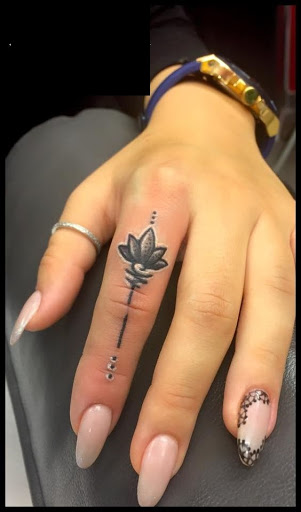 45 flower tattoos on fingers for Flower tattoos on hand