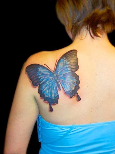 Blue Butterfly Tattoo On Girl Back Shoulder
