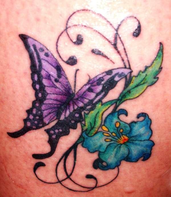 ff4d6691b Butterfly On Blue Flower Tattoo