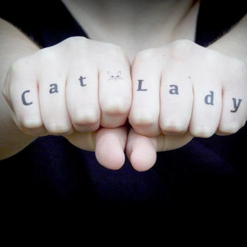 60 latest knuckle tattoos for Cat lady tattoo