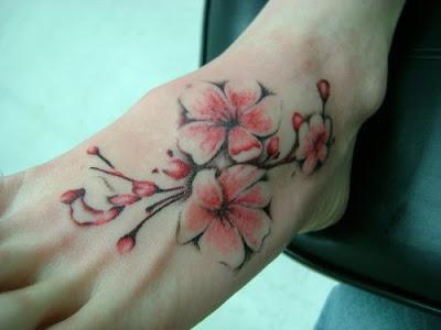 25 amazing flower tattoos on foot for girls. Black Bedroom Furniture Sets. Home Design Ideas