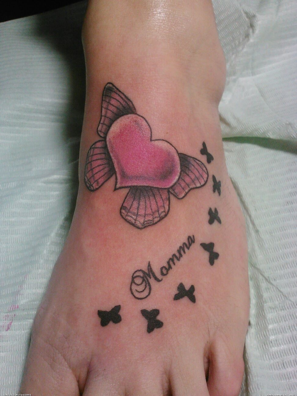 24 cute heart tattoos on foot for Pink heart tattoo