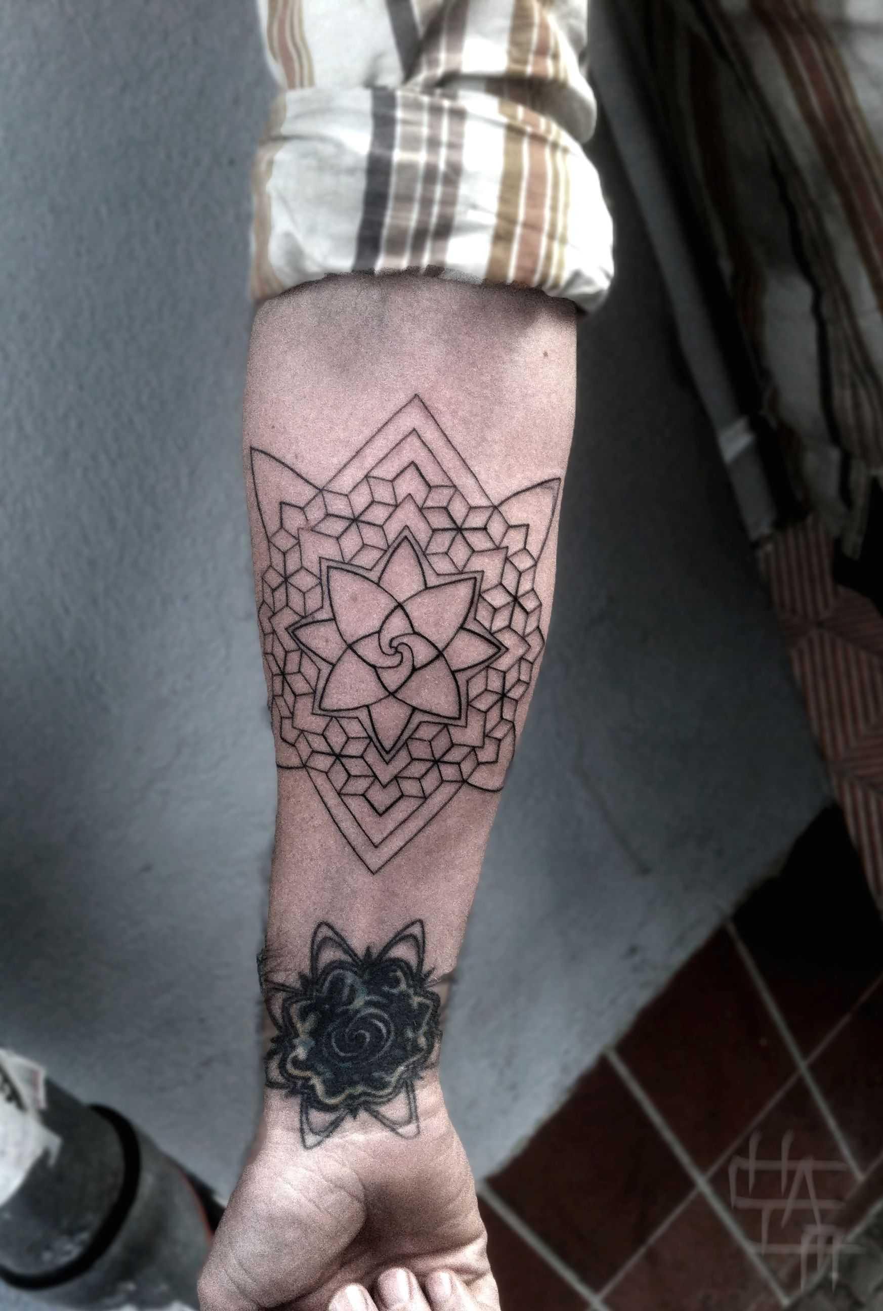 Geometric Mandala Tattoo On Forearm
