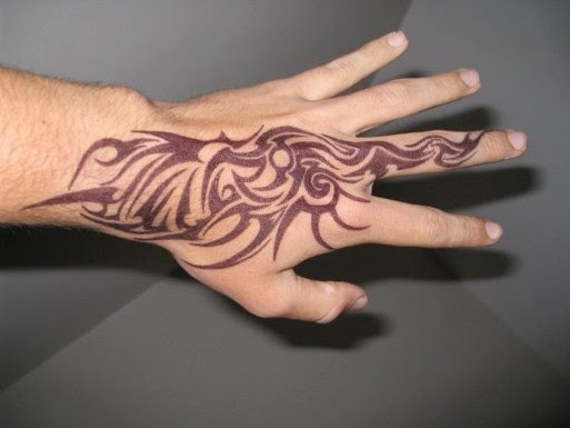 Tribal Hand Tattoo Design Idea