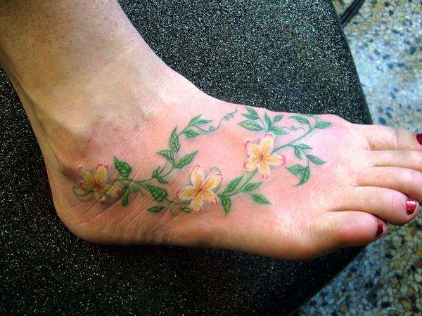 roses vine tattoo on foot for girls. Black Bedroom Furniture Sets. Home Design Ideas