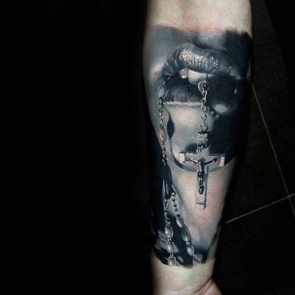 157530e66 Incredible 3D Mouth Holding Rosary Tattoo On Arm Sleeve
