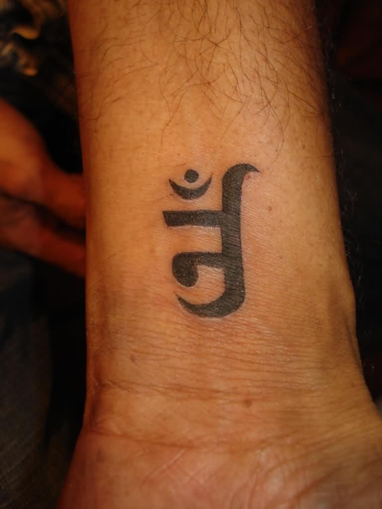 35 religious wrist tattoos for men jain om symbol religious tattoo on wrist for men buycottarizona