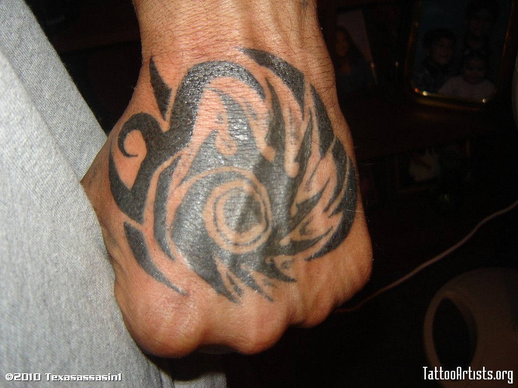 Tribal-Tattoos Nice-Black-Tribal-Tattoo-On-Left-Hand