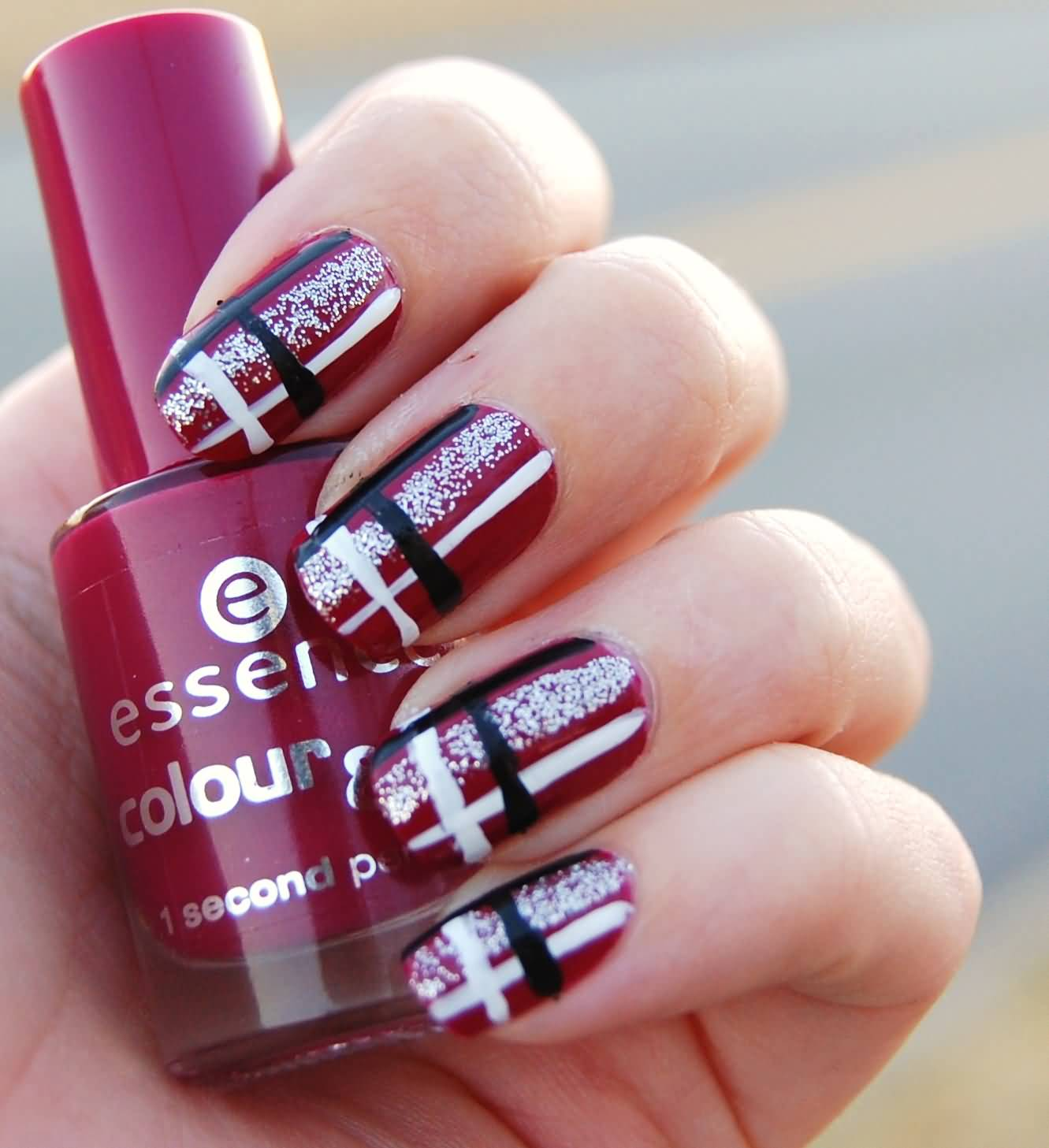 Red Base Nails With Black And White Plaid Nail Art