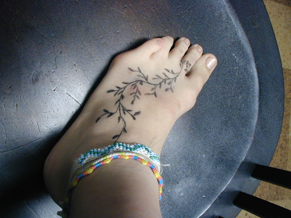 vine plant tattoo on foot for women. Black Bedroom Furniture Sets. Home Design Ideas
