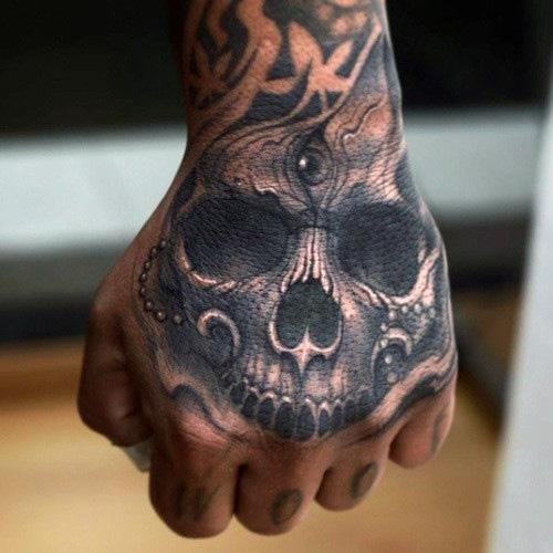 20 skull hands tattoos for men. Black Bedroom Furniture Sets. Home Design Ideas