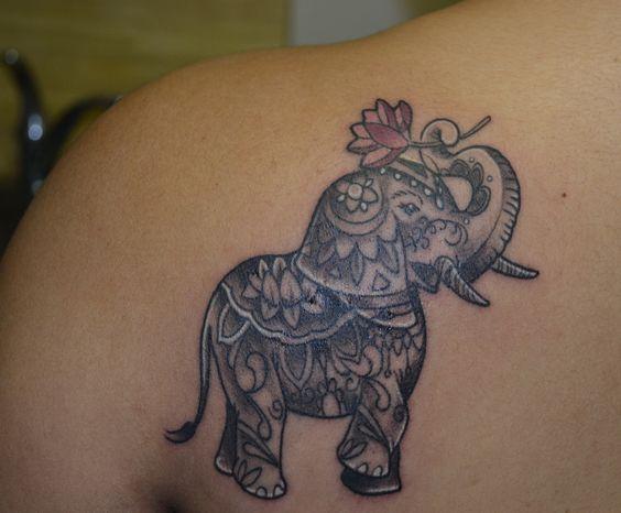 38 trunk up elephant tattoos