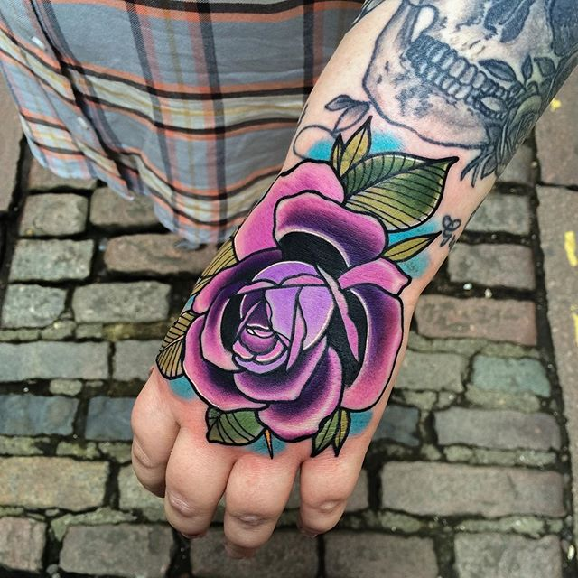 Awesome Rose Tattoo On Left Hand