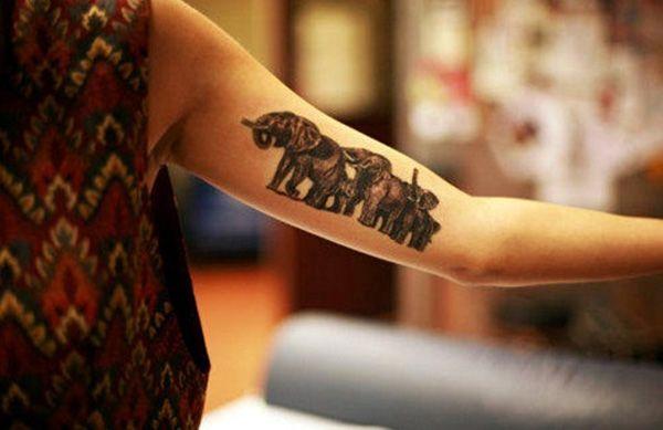 Mehndi Tattoo Half Sleeve : Black ink elephants tattoo on half sleeve