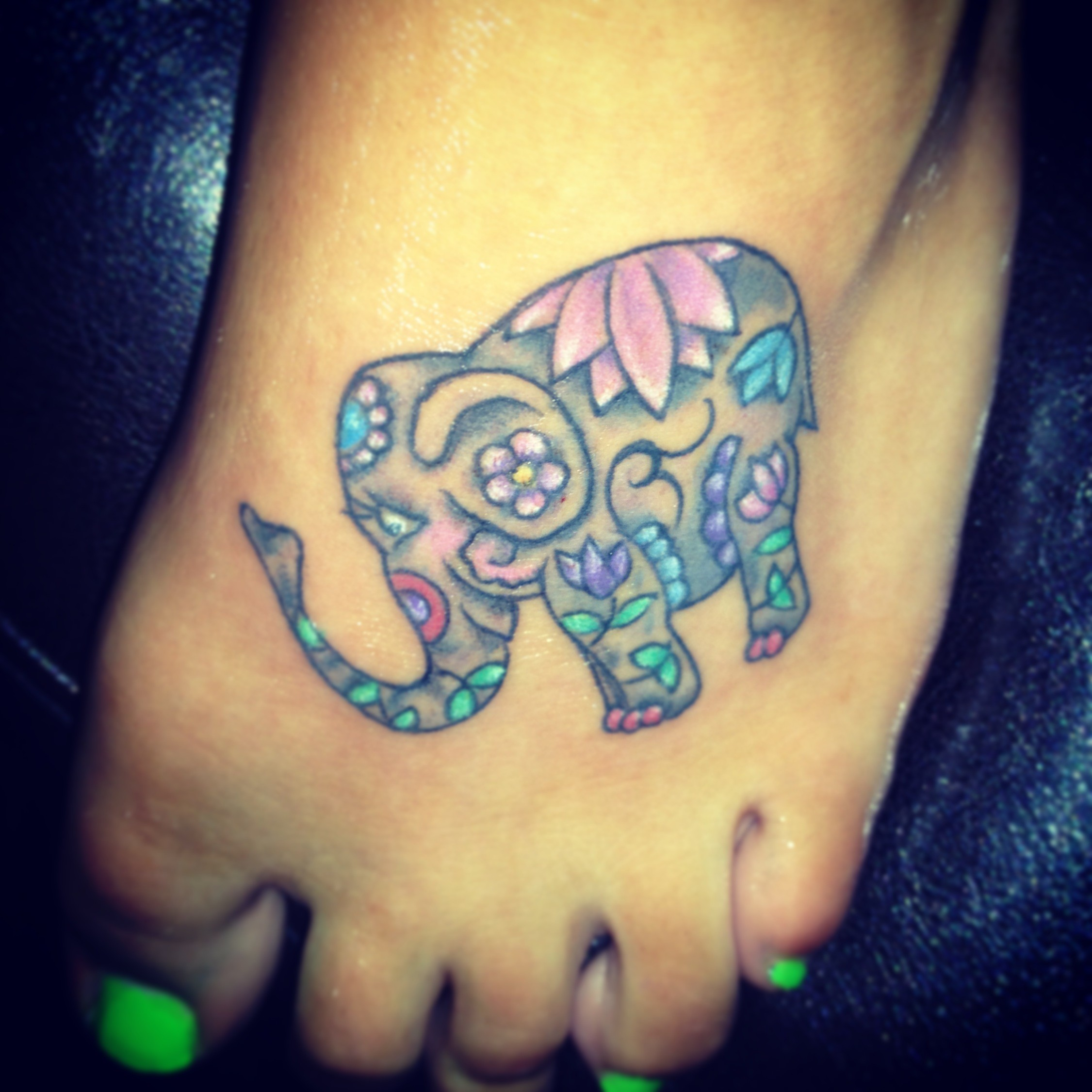 7a5ae4bdd3947 Cute Colorful Asian Baby Elephant Tattoo On Girl Left Foot