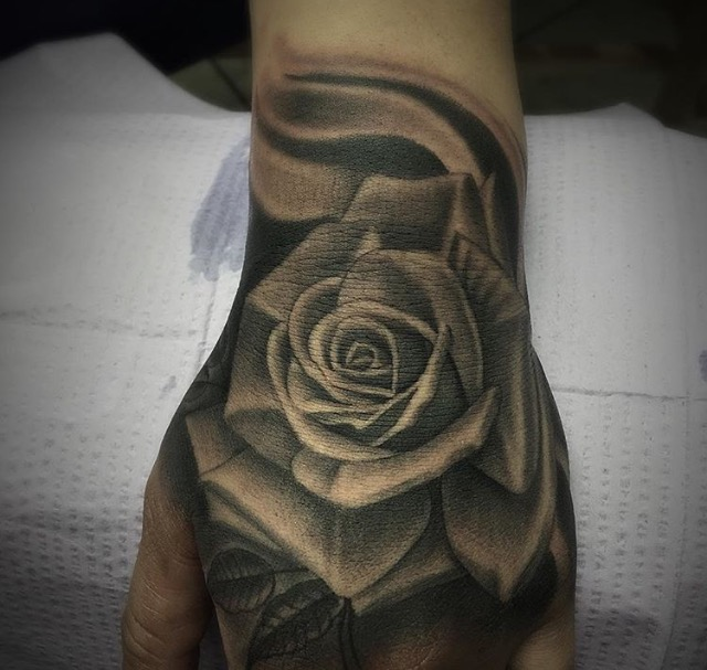 50 amazing rose hand tattoos for Black and gray rose tattoos
