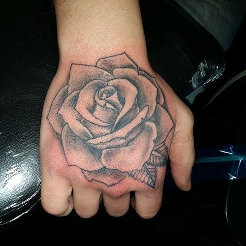50 amazing rose hand tattoos. Black Bedroom Furniture Sets. Home Design Ideas