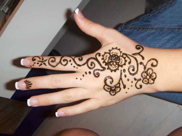Mehndi Tattoo On Hand For Girls : 30 hand tattoos for girls