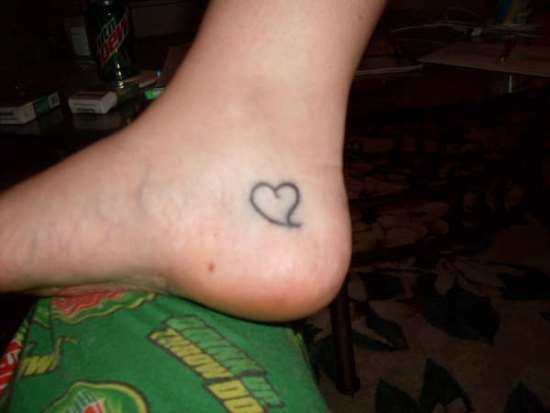 Nice small heart ankle tattoo for Small heart tattoos