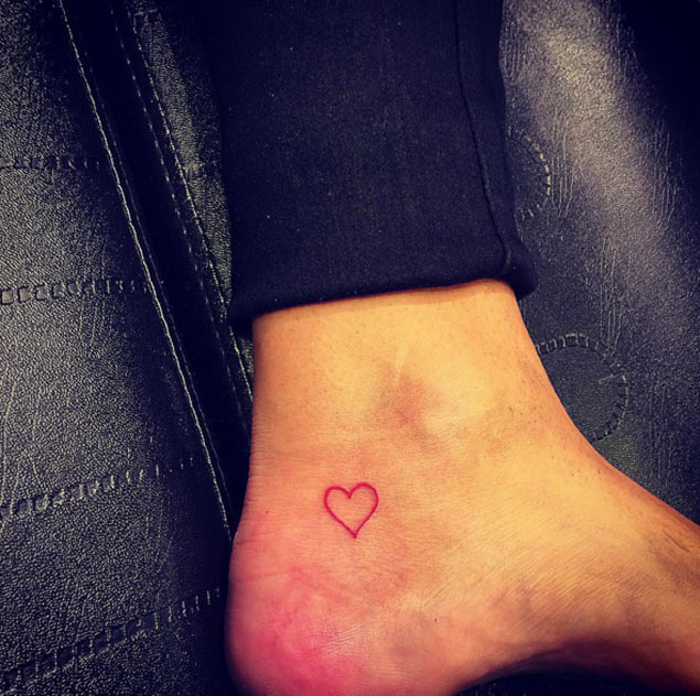 20 beautiful heart tattoos on ankle for Black heart outline tattoo meaning