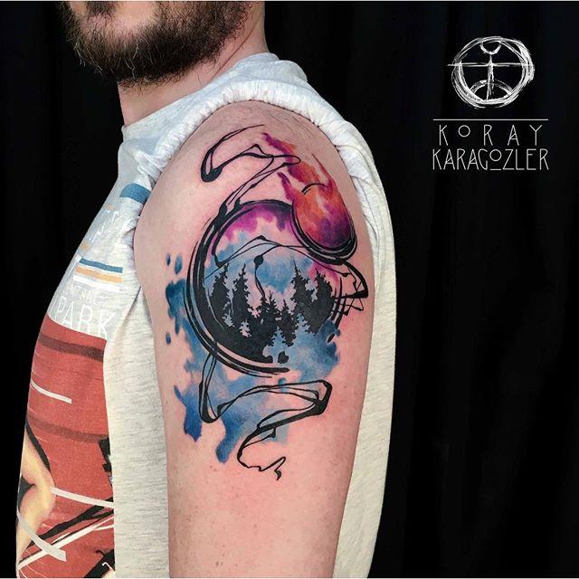 Unique Watercolor Zen Circle Tattoo On Man Left Shoulder