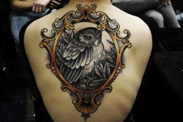 https://www.askideas.com/media/85/Black-And-Grey-Owl-In-Frame-Tattoo-On-Girl-Upper-Back.jpg