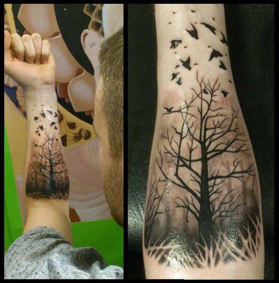 0477f011b6048 Black Ink Tree Of Life With Flying Birds Tattoo On Man Left Forearm